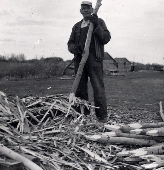 Year: 1959 Place Name: Allan, SK Image Source: John Allwood Ludvig Frydenlund getting the posts ready for fencing.