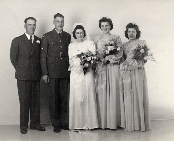 Bridal Party - Wedding of Juel & Jean Year: 1943 Place Name: Saskatoon Image Source: Charmbury's Left to right: Chris Bratlien, Juel Frydenlund, Jean Allwood Frydenlund, Joan Witney (now Moore) cousin of the bride, Inger Frydenlund (now Gore) sister of the groom.
