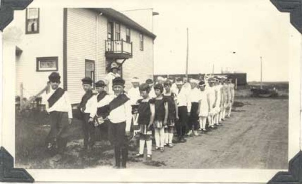 Pupils of Maynard School Year: 1925 Place Name: Donavon, SK Teacher - Charlotte Anderson - First Prize School Fair Parade