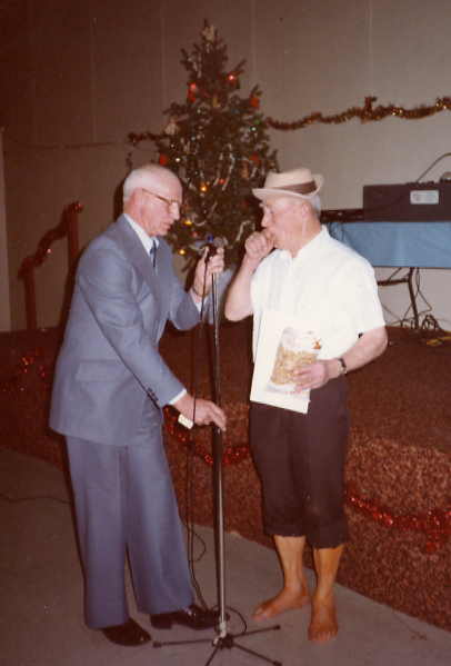 Christmas Party Year: 1984 Place Name: Saskatoon Harry Giles introducing Bert Buckle for his recitation at the 1984 Christmas Party