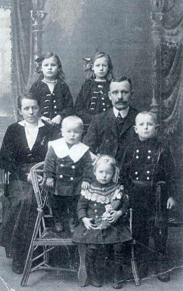Maria (back left) and her family in Ukraine