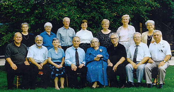 Maria and her seven children (in front) and spouses