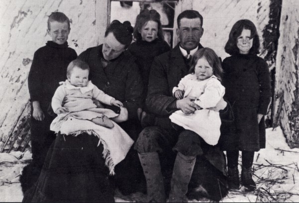 Rev. and Mrs. William English with their children Year: 1904 Place Name: Battleford, SK L to R: George, Norah, Helen, Richard (on mother\\\'s knee), and Winifred (Peggy, on father's knee)