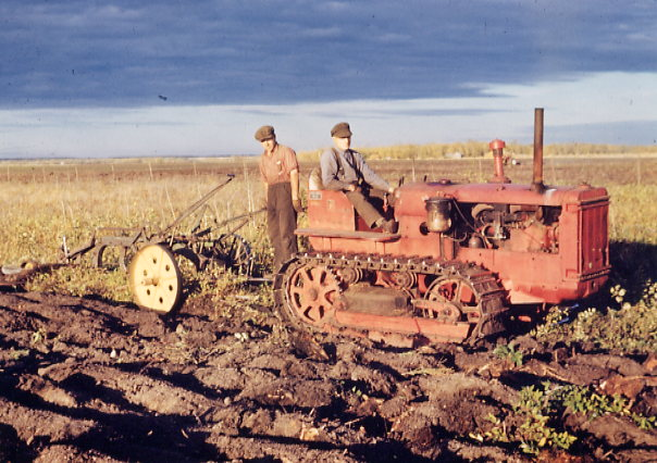 Breaking the land on the Co-op Farm Year: circa 1947 Place Name: Meskanaw Image Source: Everett Baker International tractor - TD35. Bill Chapman on the plow; Charlie Chapman operating the tractor.