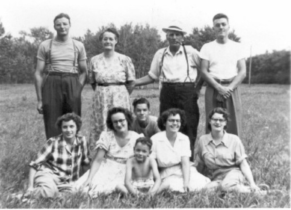 Coates Family 1950 Front Row: Tim. Second Row: Eileen, Helen, Douglas, Joan and Laura. Back Row: Walter, mother (Hazel), father (John) and Max