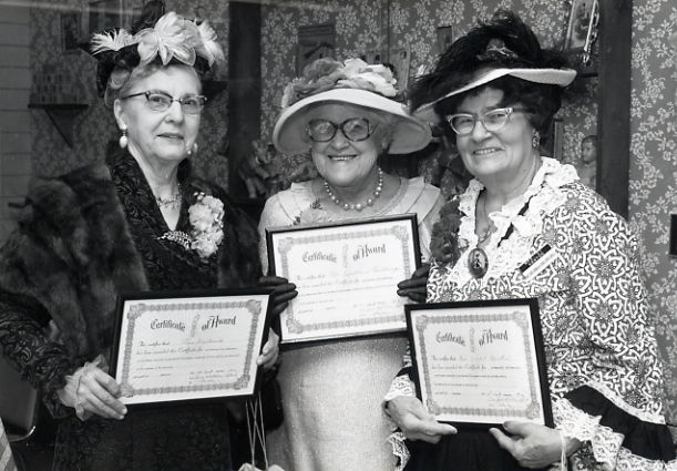 A proud moment Mrs. Hartsook, Mrs. Hutchings and Mrs. Newton Year: 1976 Place Name: Saskatoon Image Source: Gibson Photos Ltd. In the 1950s Lula (Lou Hartsook) join the Women's Auxiliary to the Western Development Museum in Saskatoon. She enjoyed volunteering there and was thrilled when she was awarded a Life Membership.