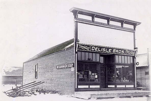 DeLisle Bros. Hardware Year: 1908 Place Name: Delisle The McCormick Hardware was the first hardware built, owned and operated by Fred and Ed DeLisle at the old townsite. In 1908 the McCormick Hardware was moved 3 miles north to the new townsite.