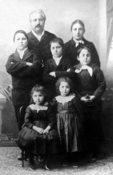 Léon Denis and Héloïse Bon family. Back row, left to right: Léon, Héloïse. 2nd row: Raymond, Clotaire, Clodomir. Front row: Marie, Maria.