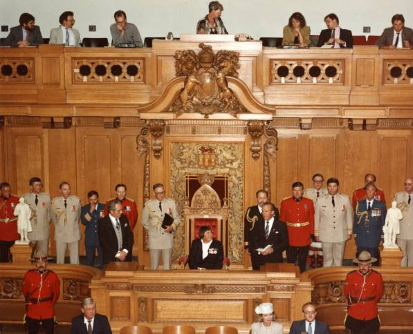 In the Speaker's Chair Year: 1988 Sept. 7, 1988- Sylvia is seated in the Speaker's Chair, has taken the oath of office and is receiving congratulations from Premier Grant Devine.