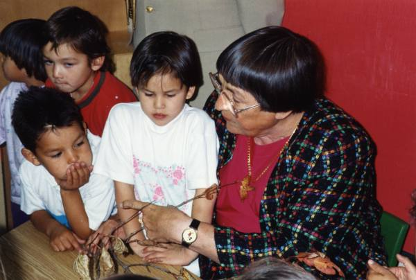 Kindergarten in Air Ronge Year: 1992 Sylvia and children in kindergarten class at Air Ronge School during the 1992 northern tour.