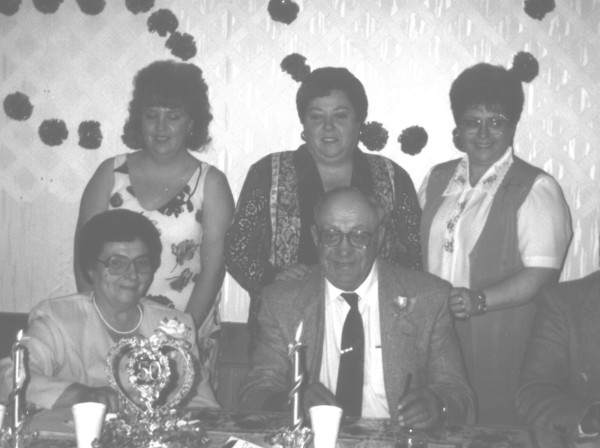 Harry and Mary Petrowski - 50th Wedding Anniversary Year: 1998 Place Name: Preeceville Image Source: Andrew Allsopp Back row - daughters Teresa Petrowski, Carol Gawrelitza, Marj Biccum Front row - Mary and Harry Petrowski