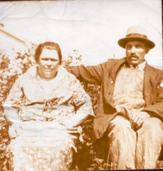 John and Veronika Meskolczi Year: 1925 Place Name: near Prud'homme, SK. Picture taken on farm where they lived with their family of nine boys and two girls.