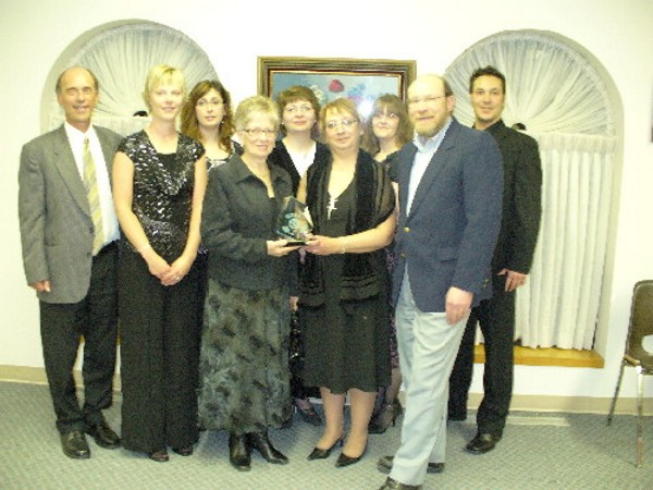 "Yorkton Chamber of Commerce - Celebrate Sucess Night Year: March 12, 2008 Place Name: Yorkton, SK In the photo, L to R: Barry Marianchuk, Tammy Smith, LeeAnna Nakonechny, Joanne Geysen, Rose Maleschuk, Carol Kitchen, Karen Rosin, Larry Off, Mike Hordichuk. Wall of Success winner at the Yorkton Chamber of Commerce ""Celebrate Success Awards"" night, March 12, 2008, in Yorkton. The ""Wall of Success"" award recognizes pioneer, corner stone business leaders who demonstrated excellence over an extended period of time, whose business has contributed to the economic wellbeing of Yorkton and immediate area. The business must have been in continuous operation for at least 15 years. Our office was nominated by an 'anonymous nominator' and was one of a three way tie winner."