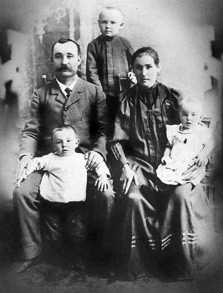 Frank & Brigetta Leier & Family Year: 1910 Place Name: The Leier's passport photo. (l/r) Frank Joseph Leier, (standing-back) Frank Jr Leier, Brigetta (Senger) Leier (front - standing) Anthony Leier (Bridgetta holding) Jacob (Jack, J.P.) Leier