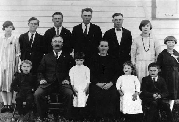 Frank & Brigetta Leier & Family Year: 1925 Place Name: Homestead in Salt Lake, SK (Back l/r) Magdalene, Henry, Jacob (Jack, JP), Frank, Tony, Leocadia, & Mary (Front (/r) Pius, Grandpa Frank, Brigetta, Grandma Brigetta, Rose & Peter