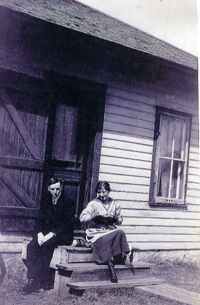 On the front steps of Bulyea home Year: 1920 Place Name: Bulyea, SK Russell and Janet on front steps of Bulyea home (Note her leather boots)