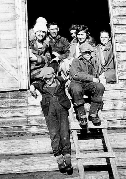 "Masons Posing in the Hayloft Year: circa 1929 Place Name: Hilldrop, SK Friend, Ross, Walter, Ethel, Violet. Front: Willie, Stanley. On the back in Ethel's handwriting: ""Mama says you'll wonder what she's doing up there. We had an awful time to get her to go up."""