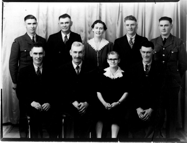 Mason Family Picture Year: 1941 Place Name: Prince Albert, SK Image Source: Voldeng's Taken just before Willie and Ross went overseas (WW II) BACK: Ernest, Howard, Ethel, Walter, Willie FRONT: Ross, Will, Violet, Stanley