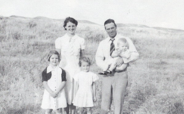 "Zelda and Staff Mickleborough, Gwen, Alma, Owen Year: 1940 Place Name: Eston River Hills at South Saskatchewan River south of Eston. Picnic at the ""ferry""."