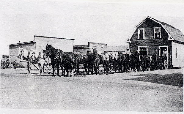 First Municipal Office Year: 1927 Place Name: Marengo Atkinson's house being moved from Merid to Marengo to serve as first municipal office. Mover Norman Stewart was paid $45.00 in Nov. for this work.