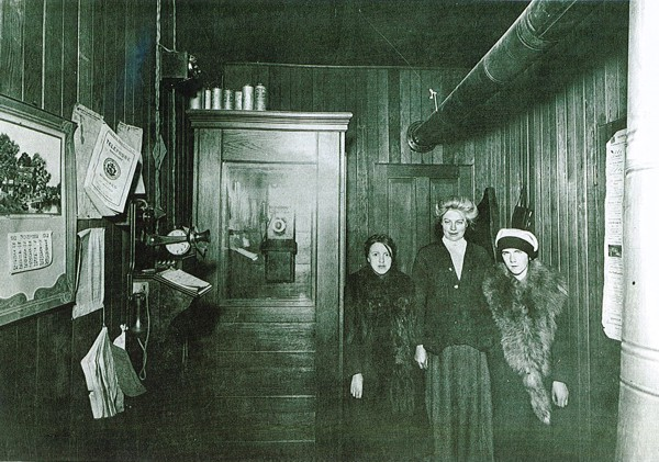 Girvin Post Office and Telephone Office Year: 1912 Place Name: Girvin L-R: Marjorie Murdoch, 'Aunt' Isobel Swanston of Guelph, Ontario (actually her mother's cousin), Unknown Girl
