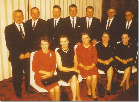 Children of Olaf and Berntine Myhr Year: 1966 Place Name: Preeceville, SK Image Source: Unknown photographer Standing Left to right: Edwin Arnold, Henry Ingman, Kenneth Wilfred, Allan Norman, Harold Melvin, Emil Alfred, Arthur Johannes Sitting Left-to right: Clara Emily, Jean Alida, Olga Beata, Aagot , Borghild Otellia