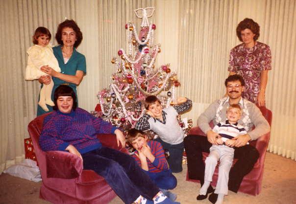 Christmas at Dave & Stella's Year: c1988 Place Name: Saskatoon, SK (L/R) Stella (holding Stacey) Susan, Derek, David, Gary (holding Gary Matthew) & Wendy