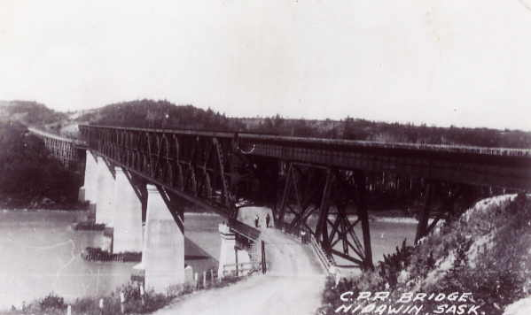 The CPR Bridge Year: 1931 Place Name: Nipawin Image Source: unknown - taken from a postcard The Nipawin CPR Bridge. Length - 1908 feet; Weight of steel work - over 4,000 tons; Cost $1.5 Million: Built 1928 - 1931. A major feat of engineering uniting the communities on both side of the river. and spurring growth and development in the area.