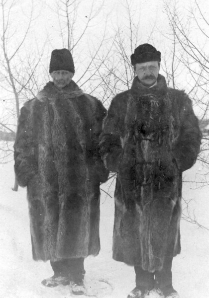 Well dressed clergy Year: 1910 Rev. Carl Norum and fellow clergyman dressed in coonskin coats.