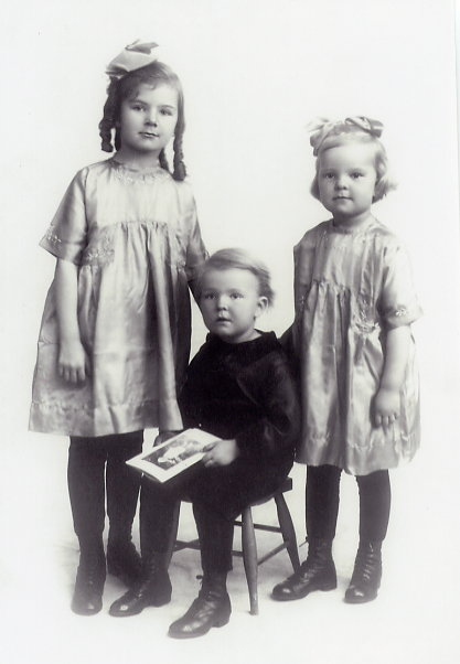 Swift Current Photography Year: 1921 Place Name: Swift Current, SK 3 Olson Children - Margaret, Carl (seated), and Lillian.