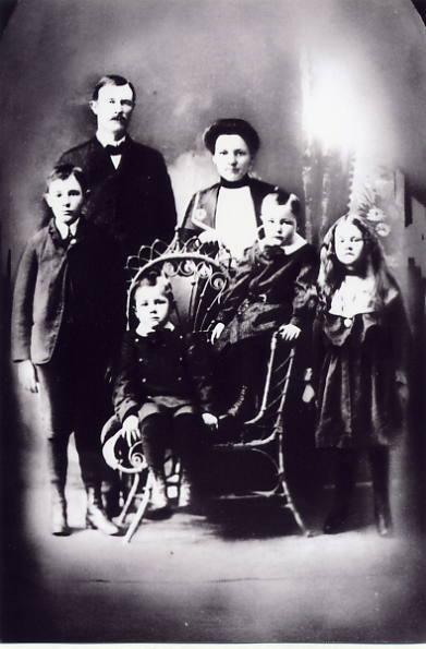 The Charles Pedersen Family Year: 1905 Place Name: Torquay, SK Left to right - Erwin, Charles, Mary, Ida Seated - Clarence and Arnold