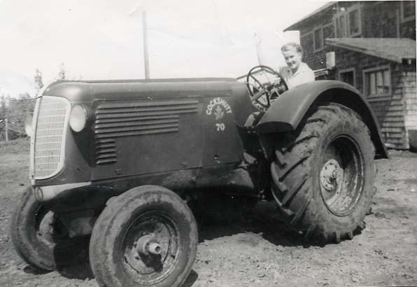 Going to school in a tractor? Year: 1949 Place Name: Duck Lake Aline all revved up and ready to leave. Taken in front of our home built by Dad.