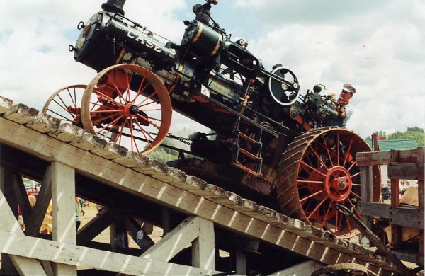 Steve Shannon operating the steam engine on the ramp Year: 1996 Pioneer Days demonstrations done by steam engine manufacturers and fairs and exhibitions to promote steam power.