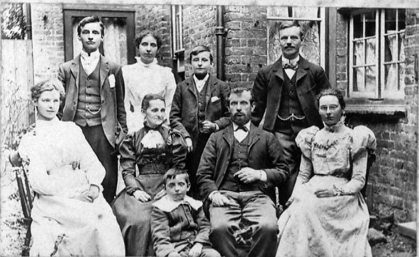 Alfred & Louisa Pocock Family Year: c.1898 Place Name: Berkhamsted Back Row: William (Mont), Alma, Walter, Henry Middle Row: Margaret (Mag), Louisa, Alfred, Fanny (Cissie) Front Row: Samuel Clifford