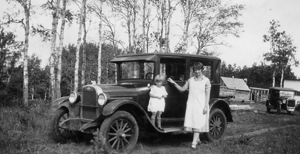 Nona, and Nora with new car Year: c. 1925 Place Name: Holbein, SK