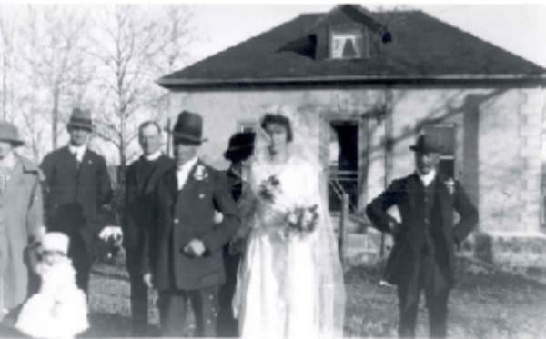 The Wedding of Thomas Potts Sr. and Mary Mather Year: 1922 At the Stone House LtoR - Mrs. Matherm child unknown, Albert Mather, Rev. J. Graham (Anglican Minister 1922-1924), Thomas Potts Sr., Mary Potts, Sarah Potts (behind bride), James Potts Sr.