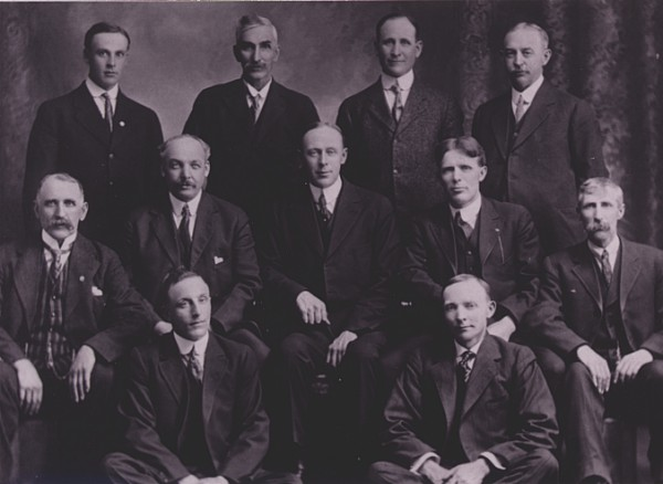 Board of Directors Year: 1916 Board of Directors Standing L-R: S.I. Lee, Hanley, Jas. Moffatt, Marcelin; W.A. Kirkpatrick, Saskatoon; P.L. Sommerfeld, Hon. Pres., Saskatoon; 2nd Row L-R: Murdo Cameron, Floral; Jno. Evans, President, Floral; A.E. Fisher, Superintendent of Insurance, Regina; C.O. Kemmish, Vice-President, Saskatoon; W. Kershaw, Saskatoon; Front Row L-R: S.J. Caught, Secretary-Manager, Saskatoon; OH.. Ingberg, Saskatoon