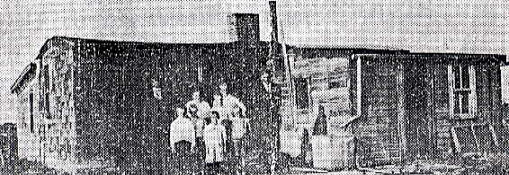 Original Homestead Place Name: Wauchope Original house with add-ons and the family standing outside