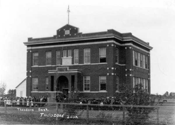 Theodore School (Third) Year: 1924 Place Name: Theodore Image Source: Not Known The third school in Theodore 1919-1961. The brick school contained 4 large classrooms and a full basement. In the early days there was a barn on the north end of the school grounds for the horses which was the main mode of transportation at the time. The brick school cost $25,000.00 to build in 1919. It was closed briefly in 1920 during the spanish influenza epidemic when it served as a hospital. The school was demolished in 1961.