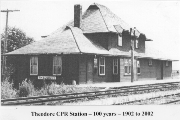 "CPR Station Year: ca. 1940 Place Name: Theodore Image Source: Not Known The original site of the CPR Station in Theodore. This building has since been relocated and now is a municipal heritage site and functions as the Theodore Historical Museum. It survived a train wreck in 1956, and turned 100 years old in 2002. The facility cost $4,000.00 to build in 1902. It is the only type 9 station in Saskatchewan of the ""Pratt Design"" which is still in useable condition. It is the only small town railway station featured in the Sask. Centennial Book ""Building Our Future"""