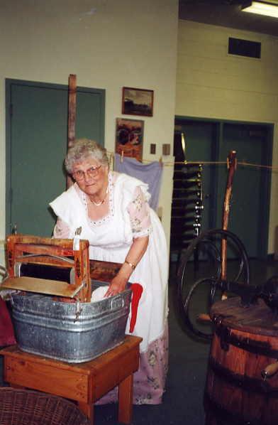 Washing clothing Year: 2000 Place Name: Saskatoon Iona Thoen washing clothing the old fashion way.